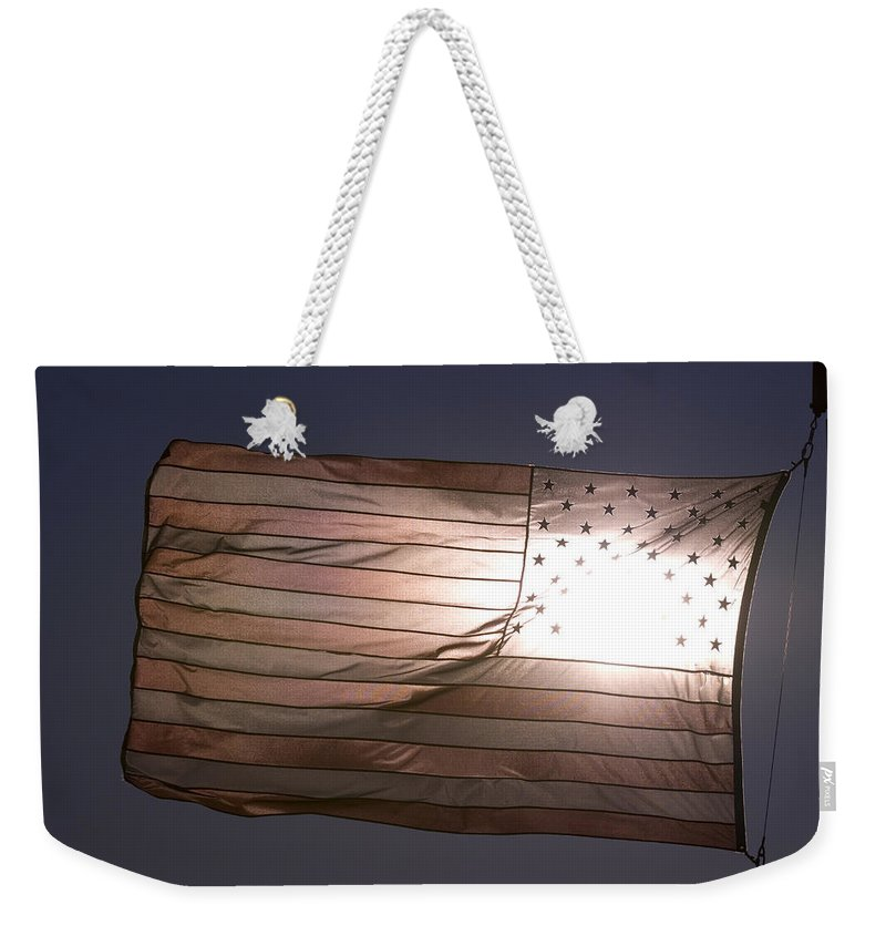 Photography Weekender Tote Bag featuring the photograph An American Flag At Sunrise by Joel Sartore