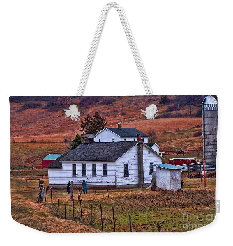 Amish Weekender Tote Bag featuring the photograph An Amish Farm by Tommy Anderson