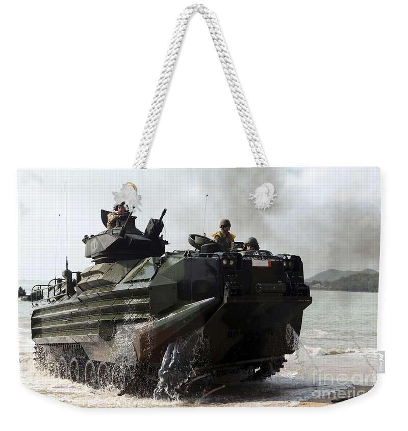 Military Weekender Tote Bag featuring the photograph An Amphibious Assault Vehicle Hits by Stocktrek Images