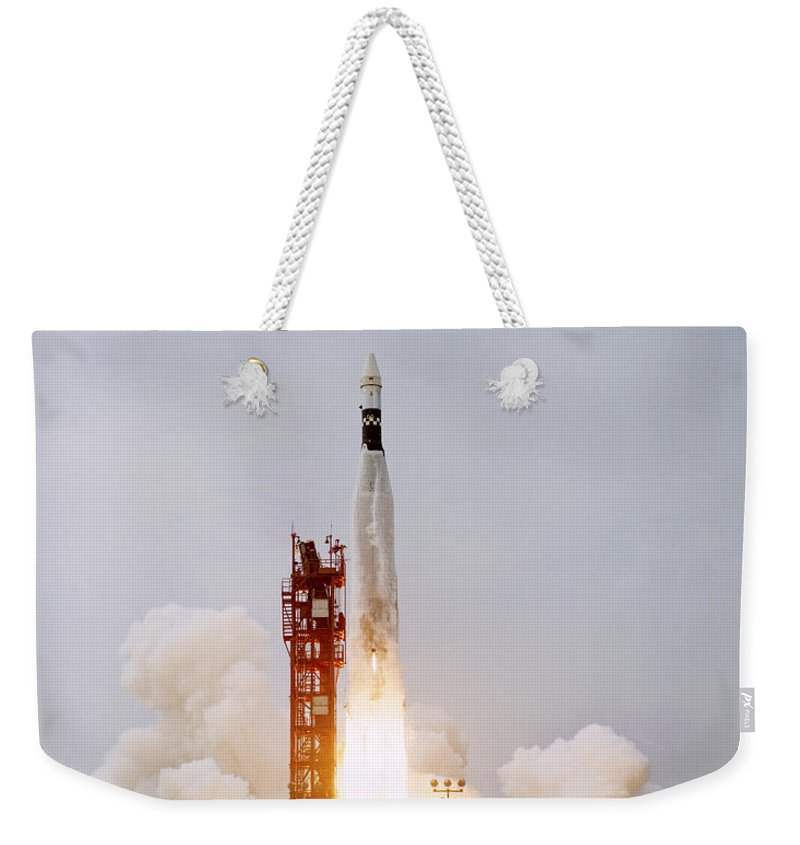 1966 Weekender Tote Bag featuring the photograph An Augmented Target Docking Adapter by Stocktrek Images