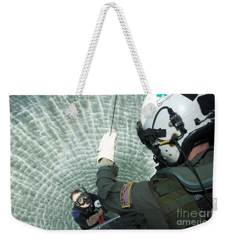 Sailor Weekender Tote Bag featuring the photograph An Aviation Rescue Swimmer Instructor by Stocktrek Images