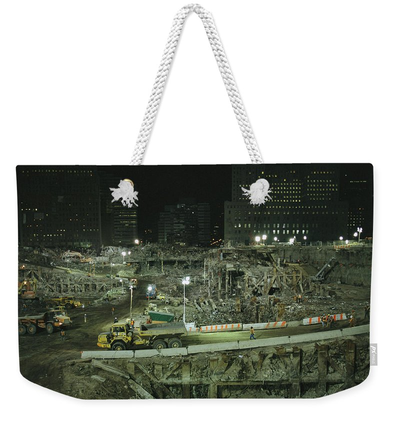 North America Weekender Tote Bag featuring the photograph An Elevated View Of Ground Zeros by Ira Block