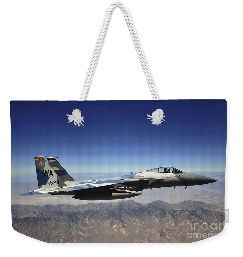 F-15 Weekender Tote Bag featuring the photograph An F-15e Strike Eagle From The 65th by Stocktrek Images