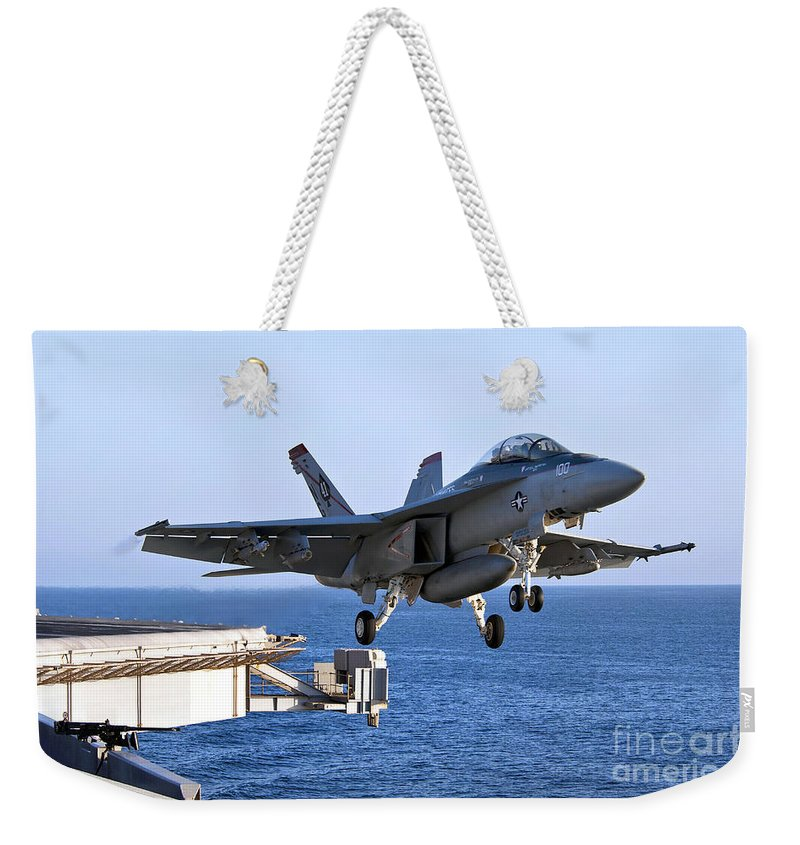 F-18 Super Hornet Weekender Tote Bag featuring the photograph An Fa-18f Super Hornet Takes by Stocktrek Images