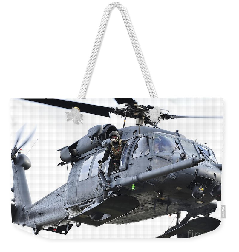 Window Weekender Tote Bag featuring the photograph An Hh-60g Pavehawk Helicopter In Flight by Stocktrek Images