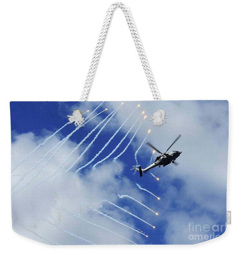 Airshow Weekender Tote Bag featuring the photograph An Hh-60h Sea Hawk Helicopter Releases by Stocktrek Images
