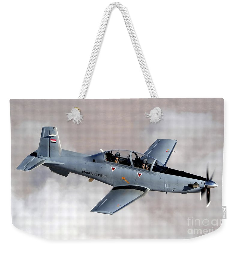 Trainer Weekender Tote Bag featuring the photograph An Iraqi Air Force T-6 Texan Trainer by Stocktrek Images