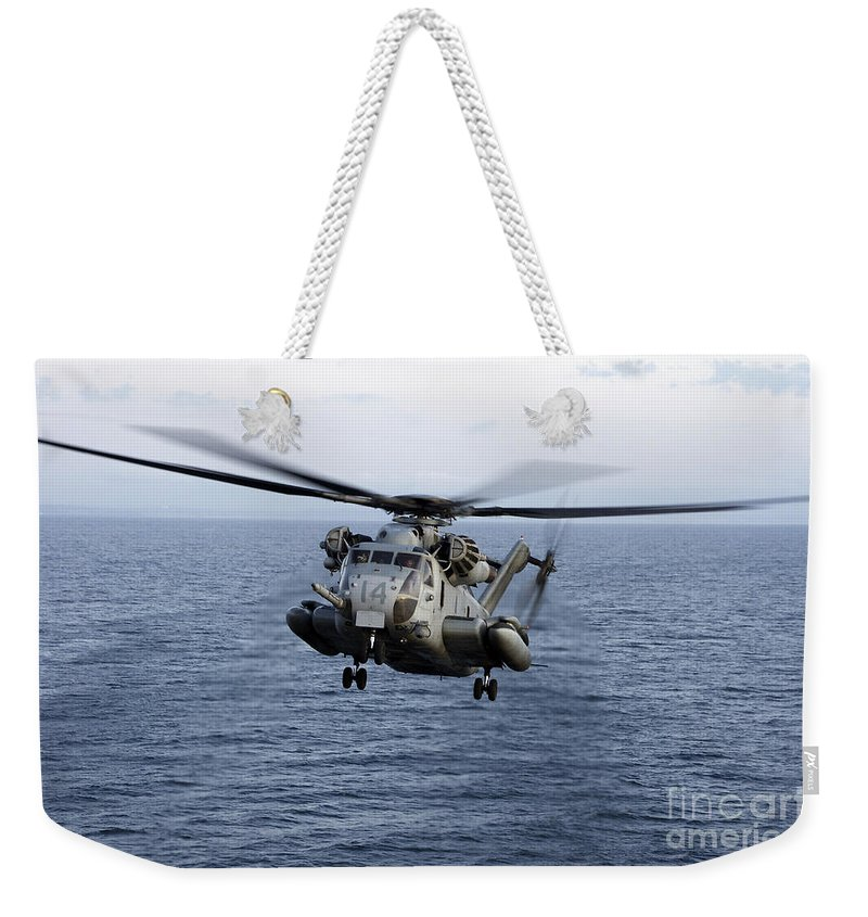 Transportation Weekender Tote Bag featuring the photograph An Mh-53e Sea Dragon In Flight by Stocktrek Images