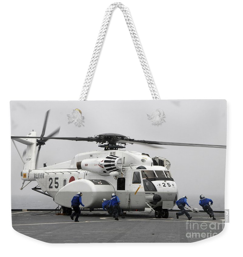 Motion Weekender Tote Bag featuring the photograph An Mh-53e Super Stallion Helicopter by Stocktrek Images