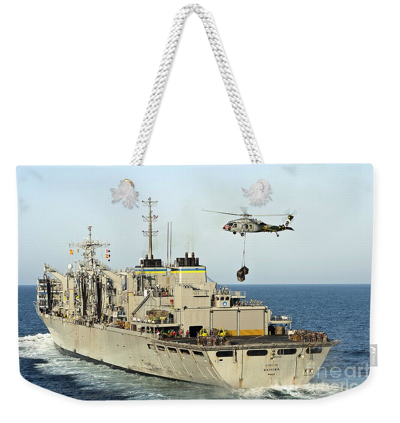 Operation Enduring Freedom Weekender Tote Bag featuring the photograph An Mh-60s Knighthawk Lifts Cargo by Stocktrek Images