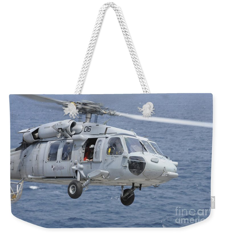 Helicopter Weekender Tote Bag featuring the photograph An Mh-60s Sea Hawk Search And Rescue by Stocktrek Images