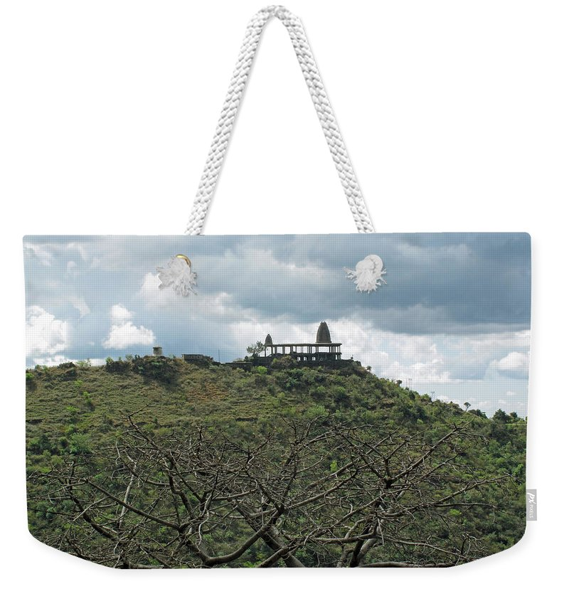 Jammu Weekender Tote Bag featuring the photograph An Old Temple Building On Top Of A Hill With A Lot Of Clouds In The Sky by Ashish Agarwal
