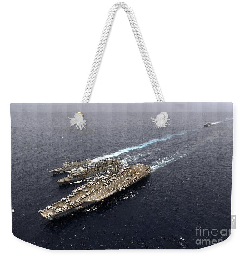 Carrier Strike Group Weekender Tote Bag featuring the photograph An Underway Replenishment With Ships by Stocktrek Images
