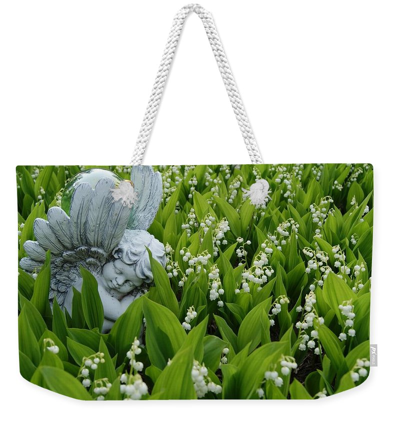 Angel Weekender Tote Bag featuring the photograph Angel In The Lilies by Steven Clipperton