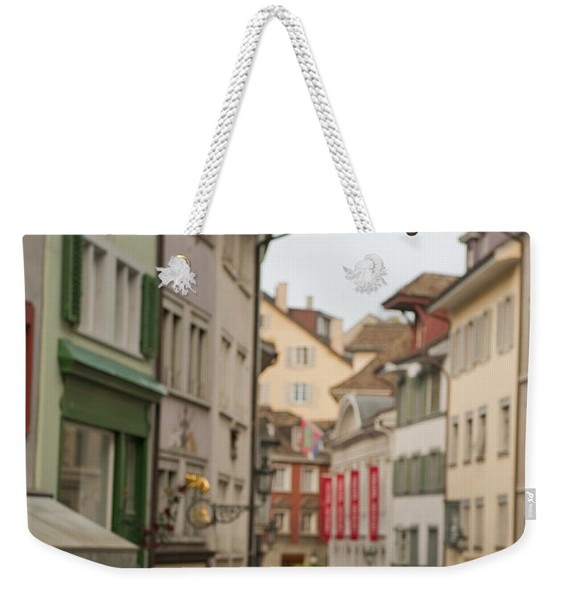 Color Image Weekender Tote Bag featuring the photograph Antique Shop Sign On A Shopping Street by Greg Dale