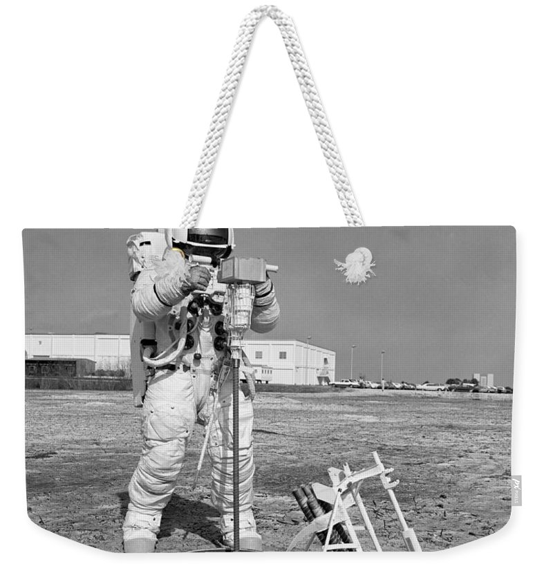 1970 Weekender Tote Bag featuring the photograph Apollo 13 Astronaut Walks by Stocktrek Images