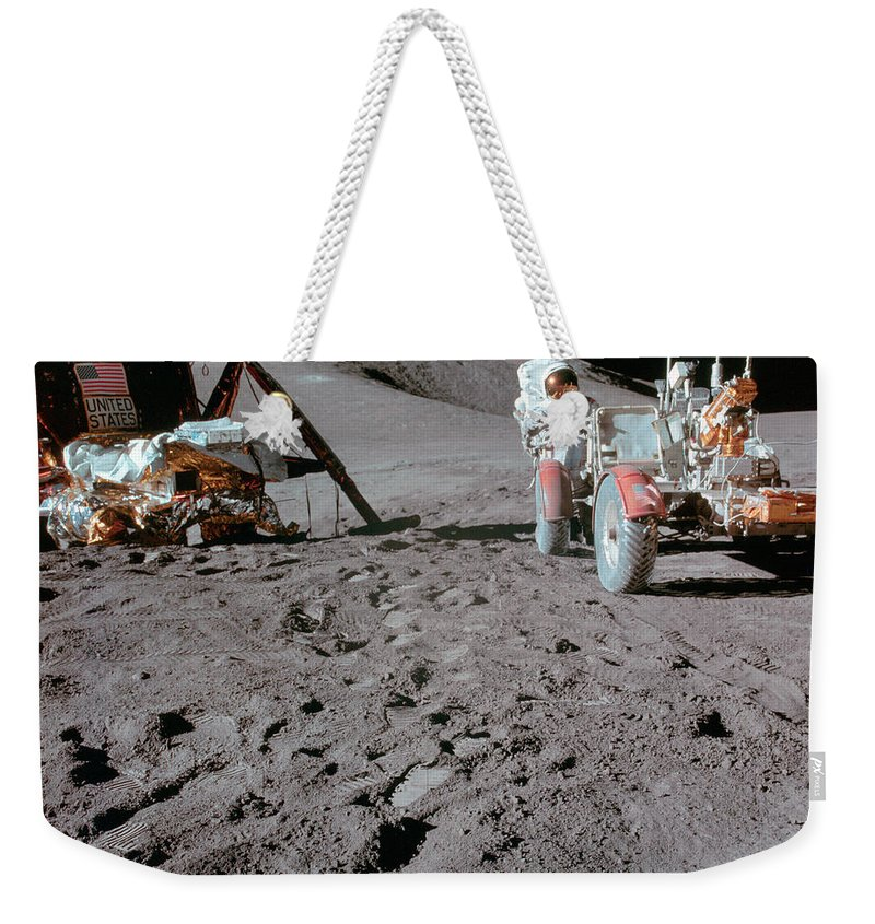 1971 Weekender Tote Bag featuring the photograph Apollo 15 Astronaut Works At The Lunar by Stocktrek Images