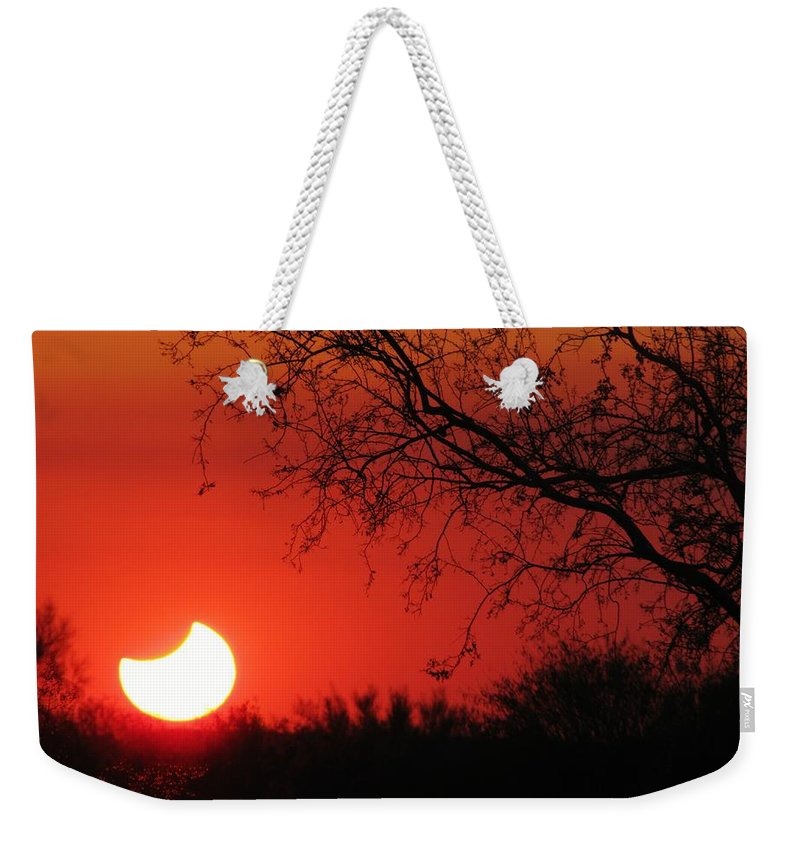 Eclipse Sunset Weekender Tote Bag featuring the photograph Arizona Eclipse At Sunset by Michelle Cassella