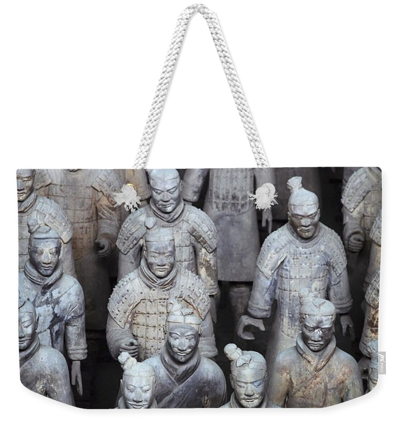 No People Weekender Tote Bag featuring the photograph Army Of Terracotta Warriors In Xian by Axiom Photographic