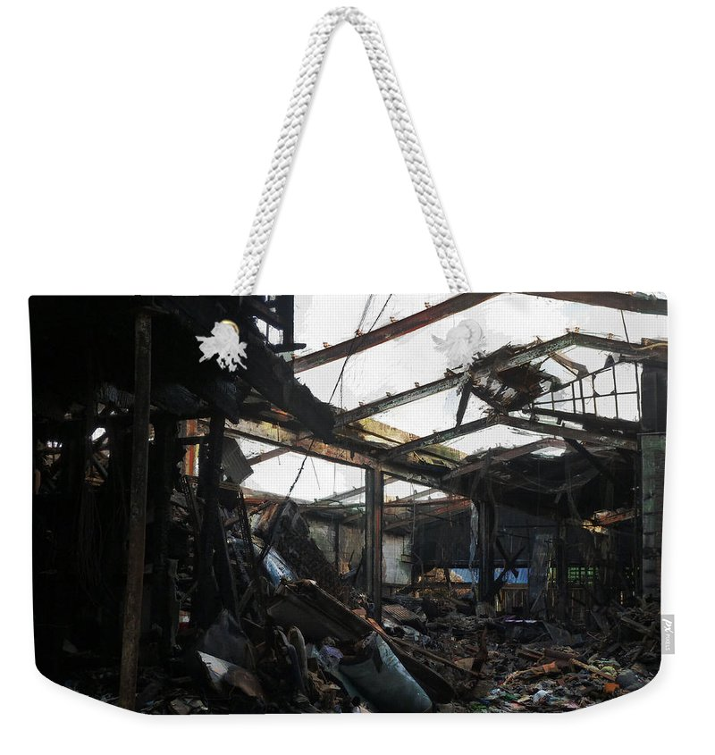 Arson Weekender Tote Bag featuring the photograph Arson Is Never Very Pretty by Steve Taylor