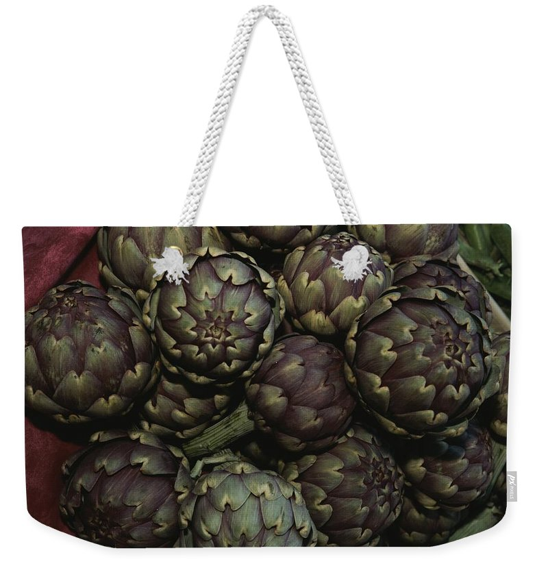 Europe Weekender Tote Bag featuring the photograph Artichokes At A Market In Provence by Nicole Duplaix