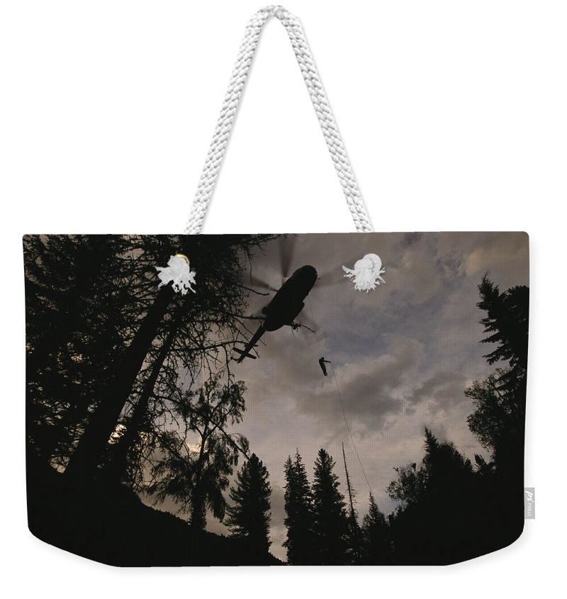 Aircraft Weekender Tote Bag featuring the photograph As Many As 20 Firefighters Can Rappel by Mark Thiessen
