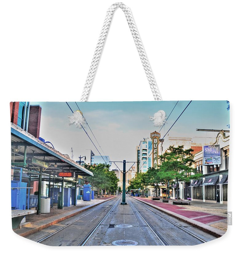 Weekender Tote Bag featuring the photograph As You Enter Downtown Buffalo Main St by Michael Frank Jr