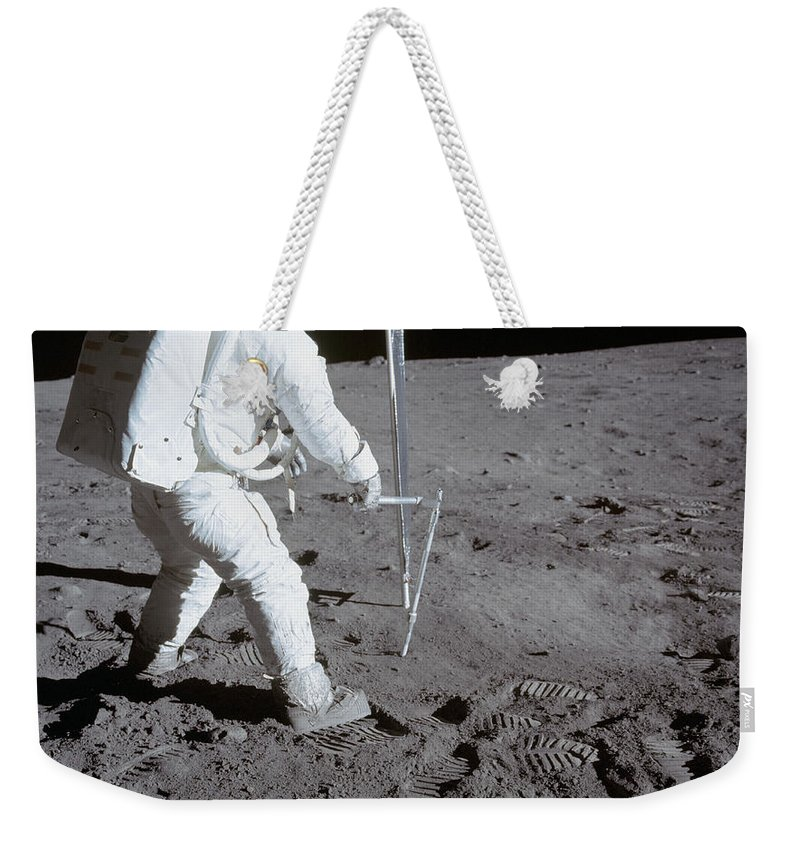 1969 Weekender Tote Bag featuring the photograph Astronaut During Apollo 11 by Stocktrek Images