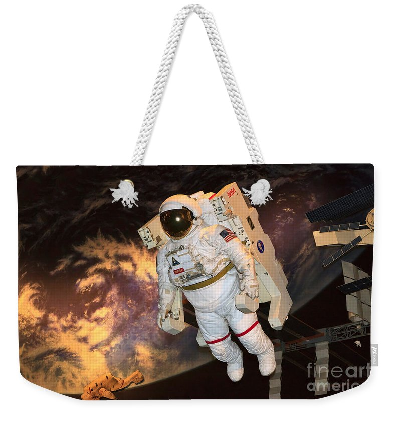Astronaut Weekender Tote Bag featuring the photograph Astronaut In A Space Suit by Louise Heusinkveld