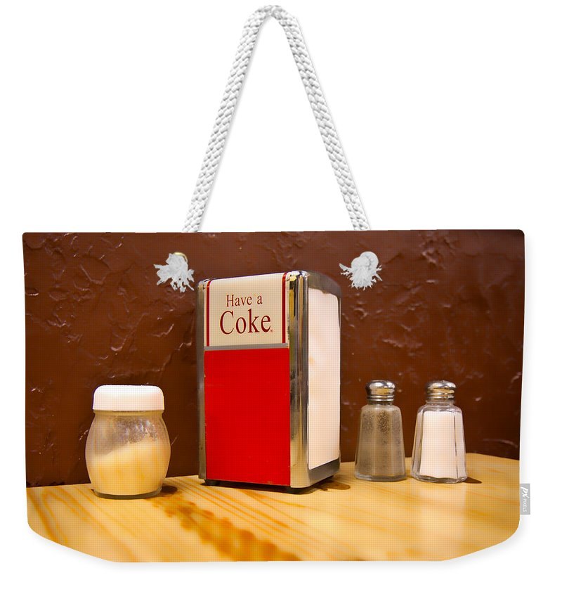 Coke Weekender Tote Bag featuring the photograph At The Table by Betsy Knapp