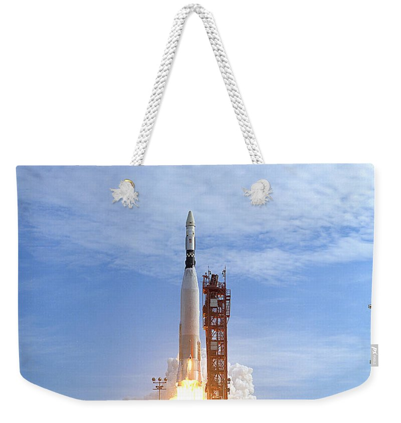 1966 Weekender Tote Bag featuring the photograph Atlas Agena Target Vehicle Liftoff by Stocktrek Images