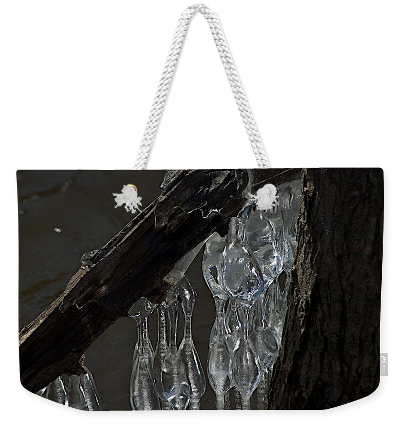 Ice Weekender Tote Bag featuring the photograph Attached by Joseph Yarbrough