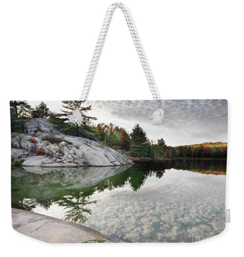 Lake Weekender Tote Bag featuring the photograph Autumn Nature Lake Rocks And Trees by Oleksiy Maksymenko