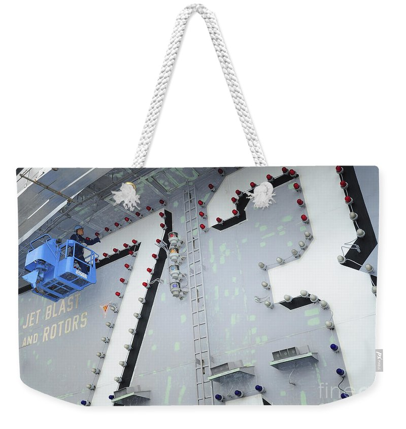 Maintenance Weekender Tote Bag featuring the photograph Aviation Boatswains Mate Paints by Stocktrek Images