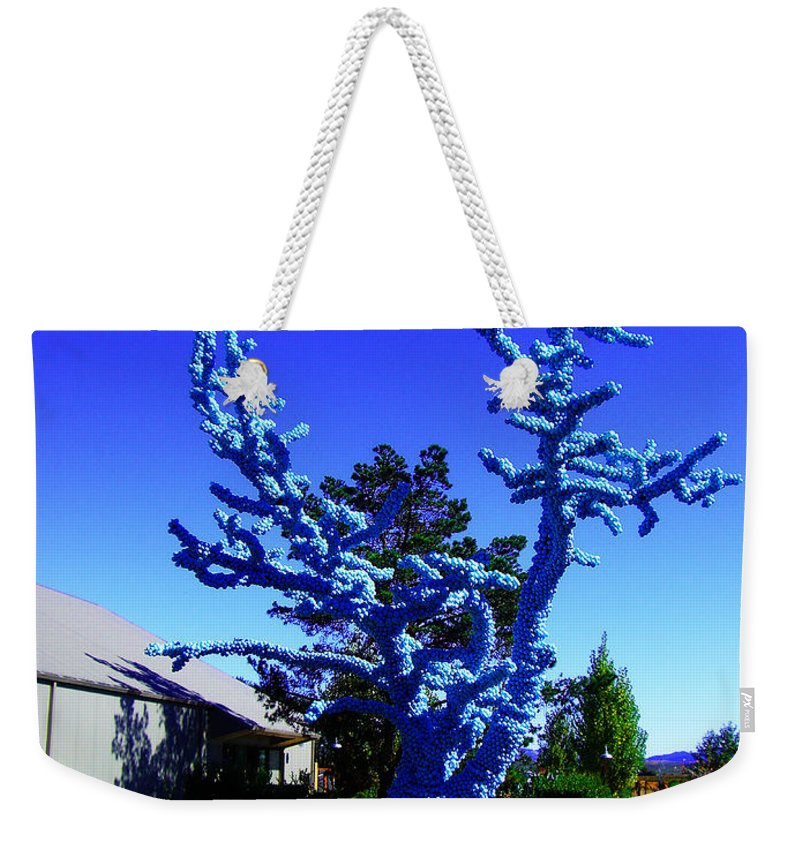 Baby Blue Tree Weekender Tote Bag featuring the photograph Baby Blue Tree by Xueling Zou