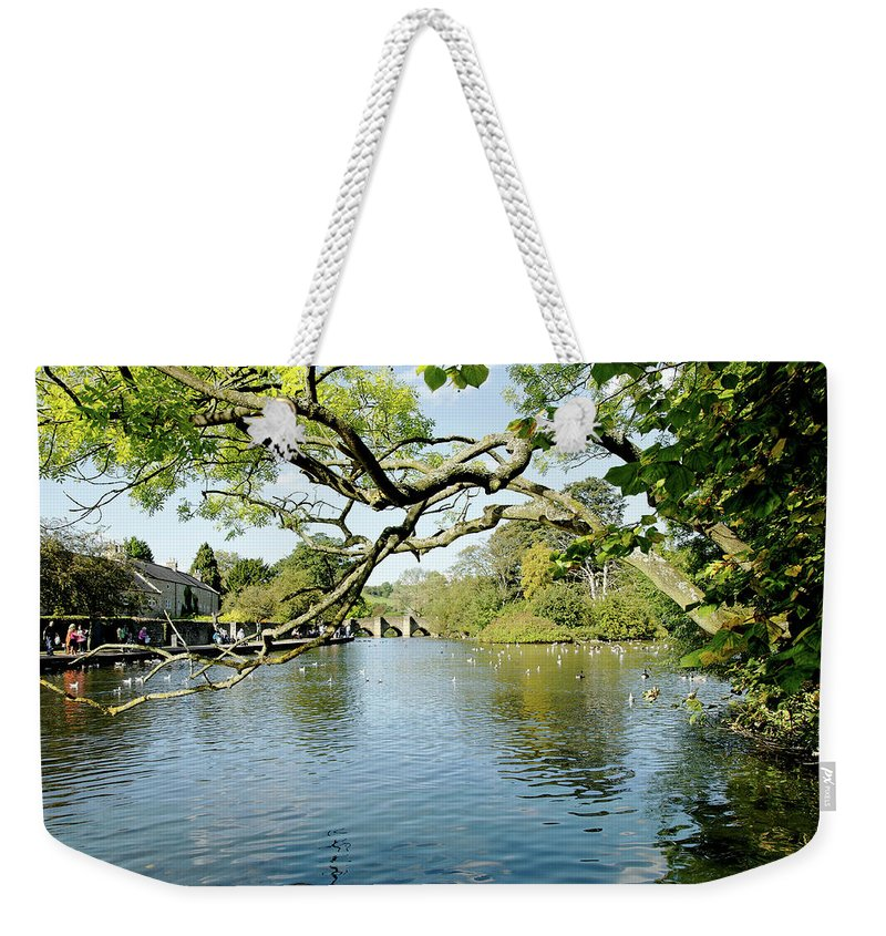 Bakewell Weekender Tote Bag featuring the photograph Bakewell Riverside - Through The Branches by Rod Johnson