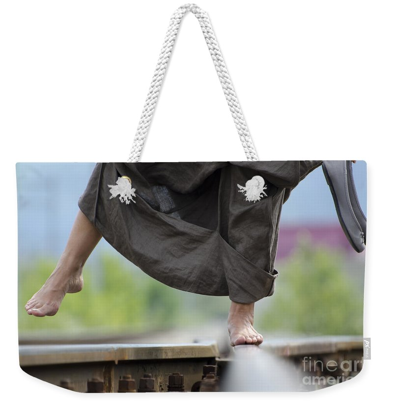 Shoes Weekender Tote Bag featuring the photograph Balance On Railroad Tracks by Mats Silvan