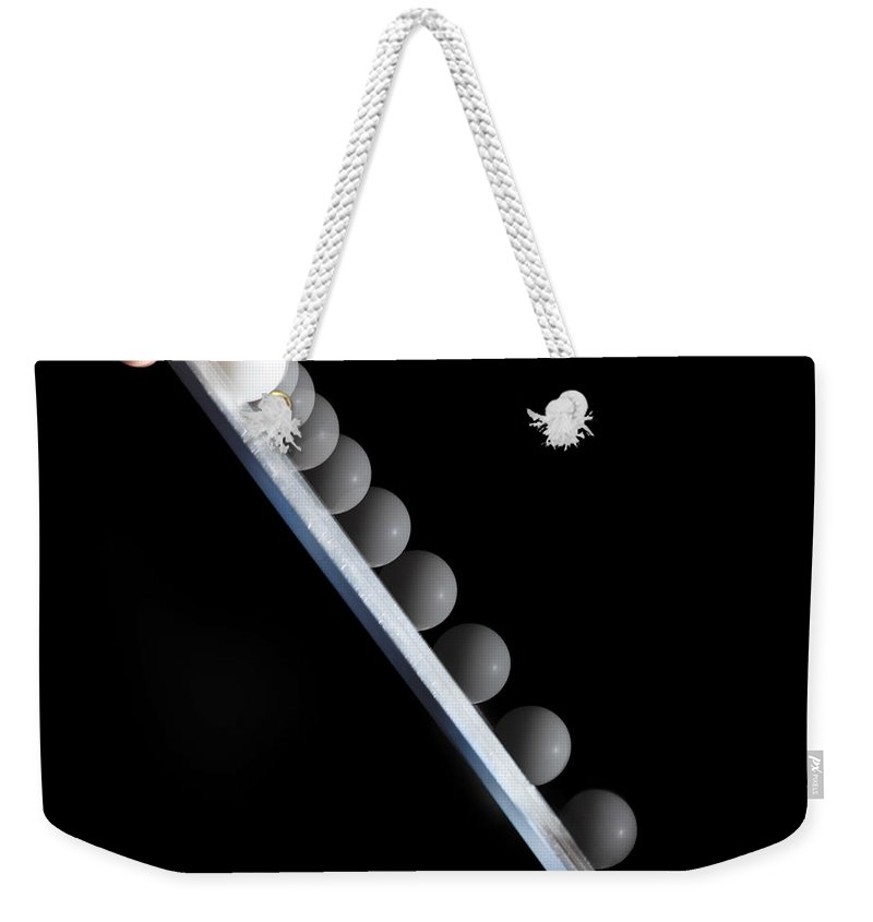 Action Weekender Tote Bag featuring the photograph Ball Accelerating by Ted Kinsman