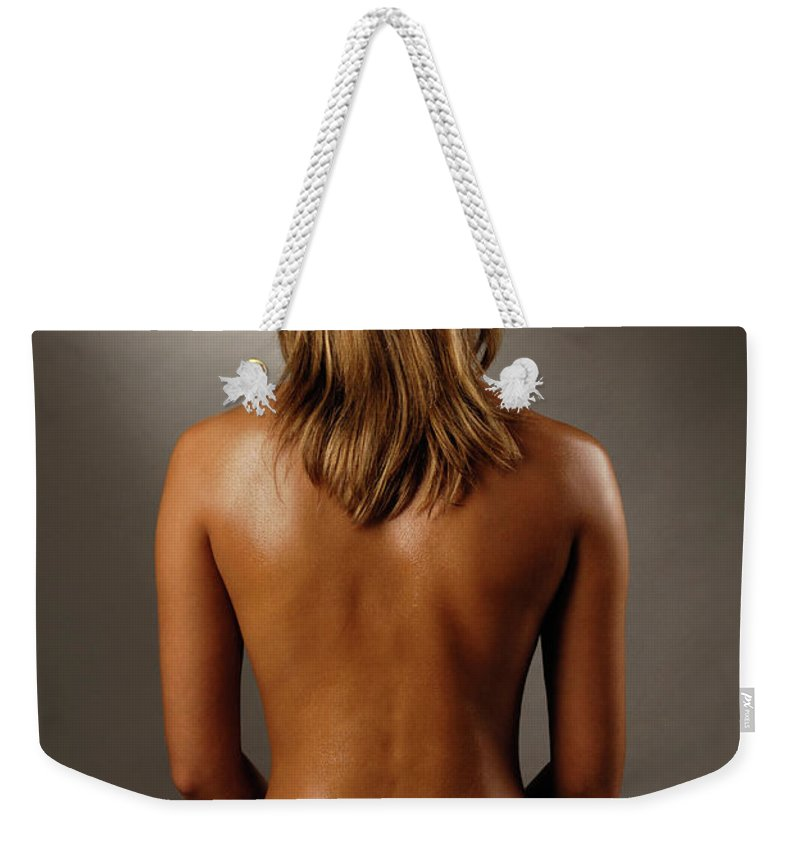 Woman Weekender Tote Bag featuring the photograph Bare Back Of A Suntanned Woman In A Straw Hat by Oleksiy Maksymenko