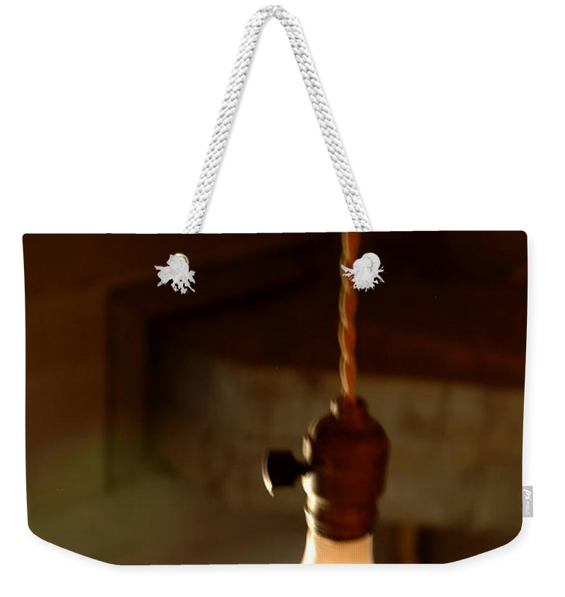 Usa Weekender Tote Bag featuring the photograph Bare Bulb Swinging by LeeAnn McLaneGoetz McLaneGoetzStudioLLCcom