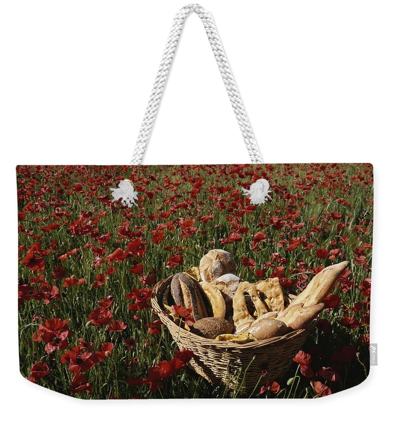 Europe Weekender Tote Bag featuring the photograph Basket Of Bread In A Poppy Field by Nicole Duplaix