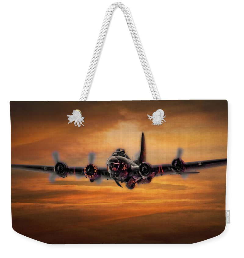 Aviation Weekender Tote Bag featuring the photograph Battle Scarred But Heading Home by Chris Lord