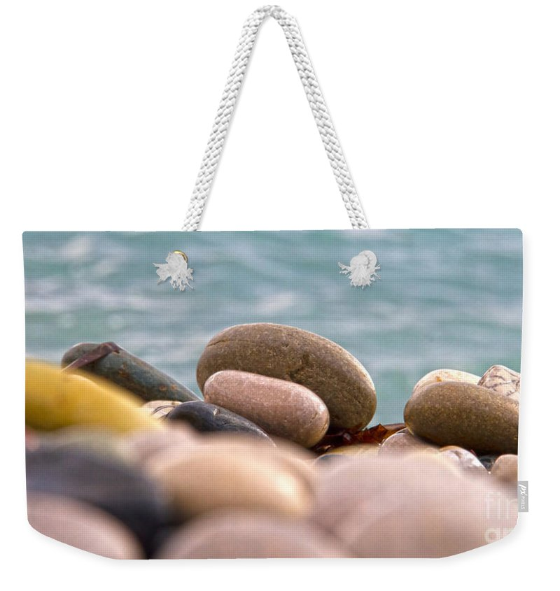 Abstract Weekender Tote Bag featuring the photograph Beach And Stones by Stelios Kleanthous