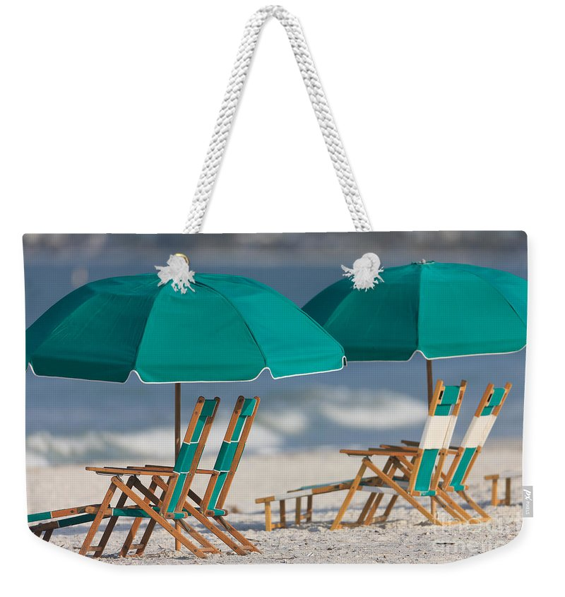 Clarence Holmes Weekender Tote Bag featuring the photograph Beach Furniture I by Clarence Holmes