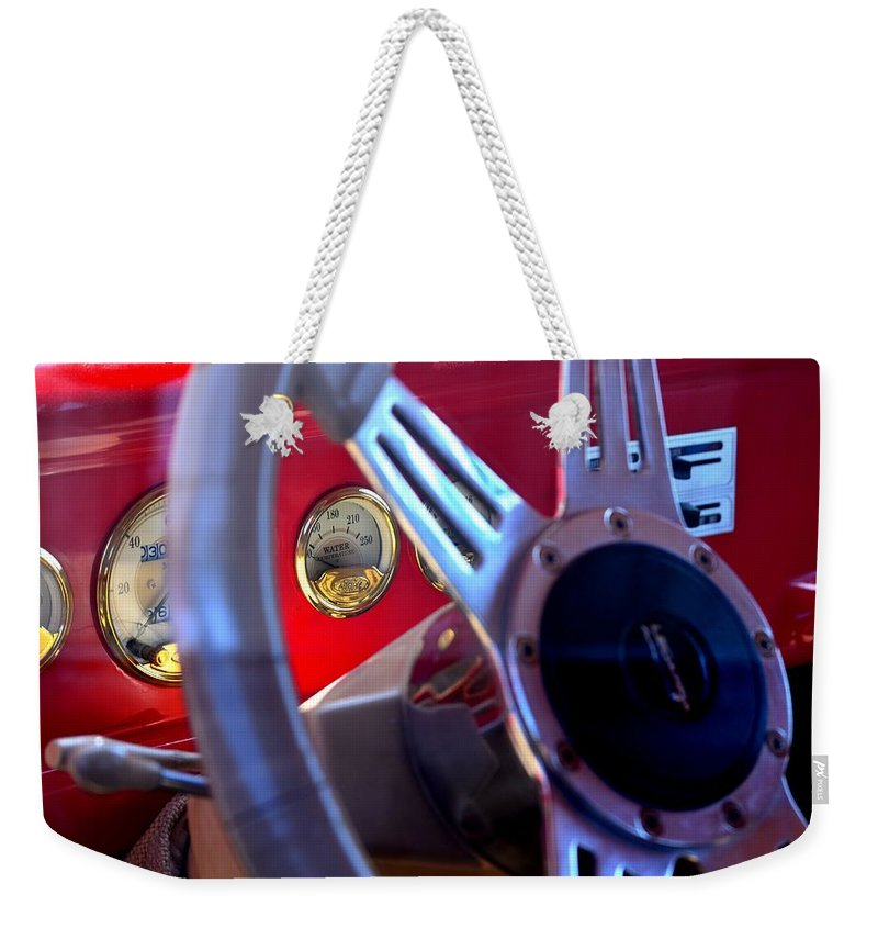 Ford Weekender Tote Bag featuring the photograph Behind The Wheel Of A 1940 Ford by Maria Urso