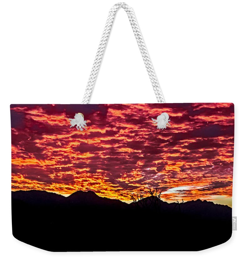 Sunrise Weekender Tote Bag featuring the photograph Believe It Or Not by Robert Bales
