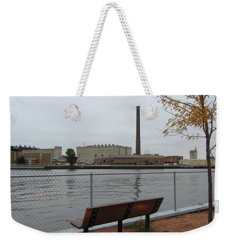 Milwaukee Weekender Tote Bag featuring the photograph Bench With Industrial View by Anita Burgermeister
