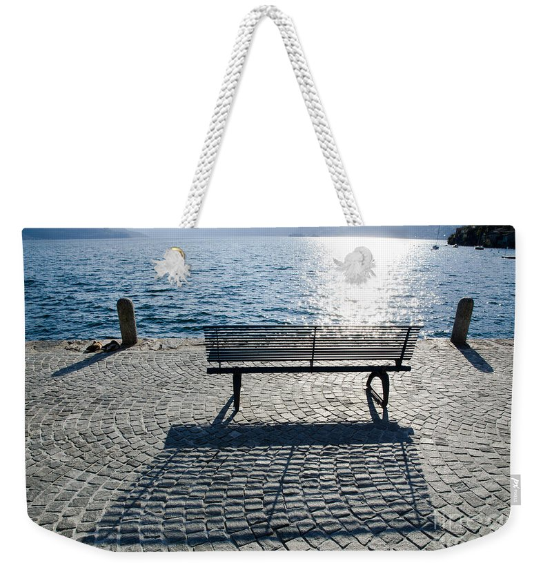 Bench Weekender Tote Bag featuring the photograph Bench With Shadow by Mats Silvan