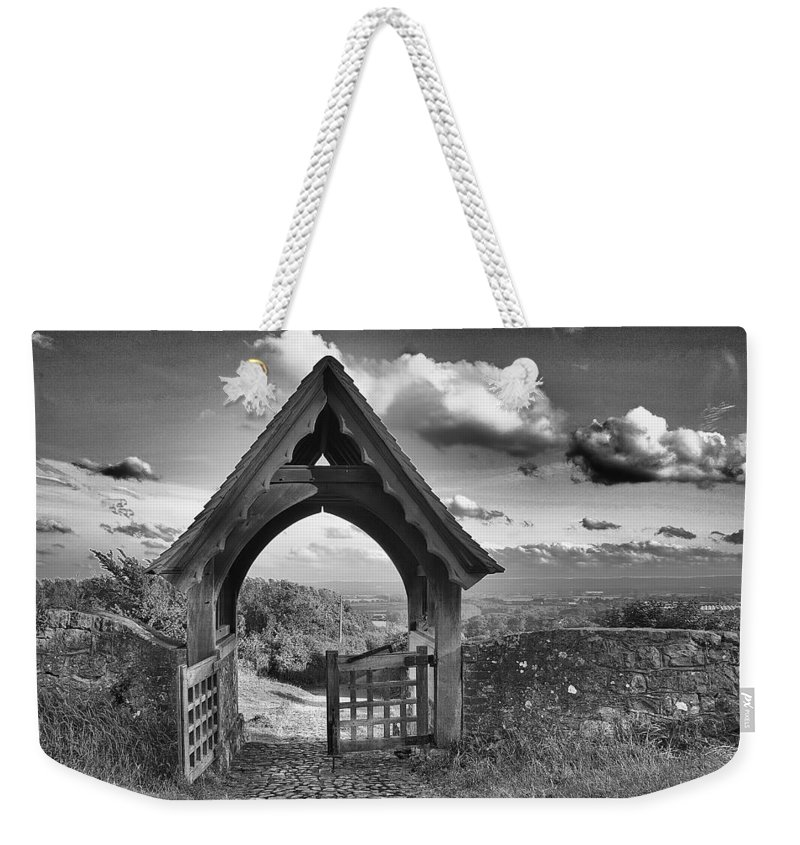View Weekender Tote Bag featuring the photograph Beyond The Gate by Dave Godden