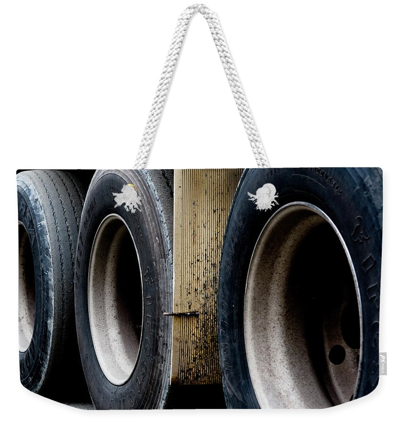 Urban Images Weekender Tote Bag featuring the photograph Big Fat Tires by Lorraine Devon Wilke